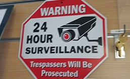 image of a 24 hour surveillance logo