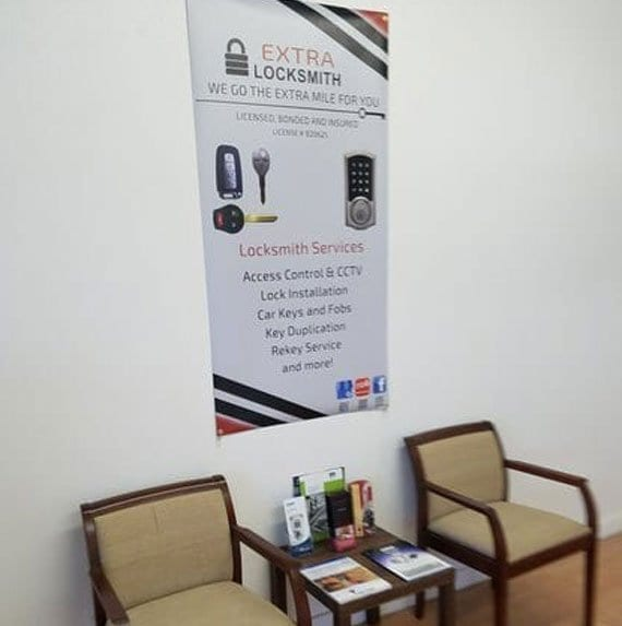 Picture inside Extra Locksmith store with 2 chairs and a poster